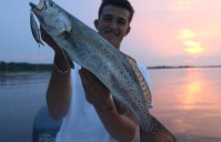 "INSHORE, ABOARD ""THE BLACK SHEEP"" – Bulls, Slot Reds, Trout and Flounder"