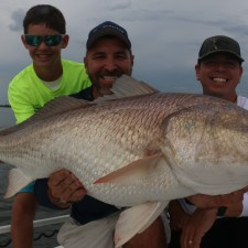 Rob Chapman of 360 Outdoors and crew with a Massive Bull Red